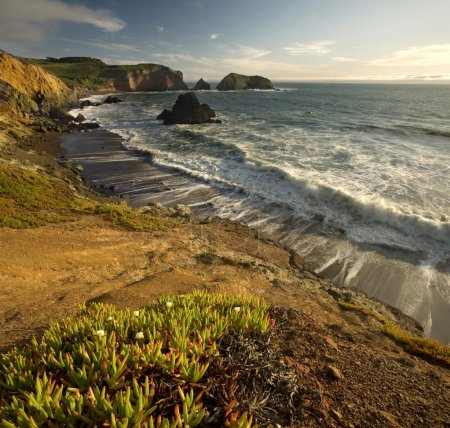 Photo of the cliffs at Rodeo Beach in the Marin He...