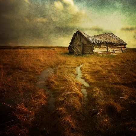 Photo for Old haunted house on the empty field - Royalty Free Image