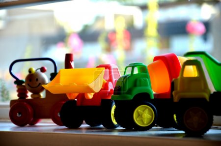 Photo for Child toy cars in a row - Royalty Free Image