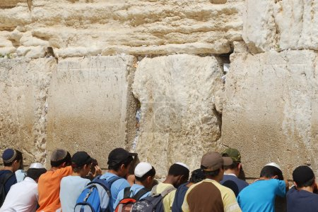 Praying at Western wall