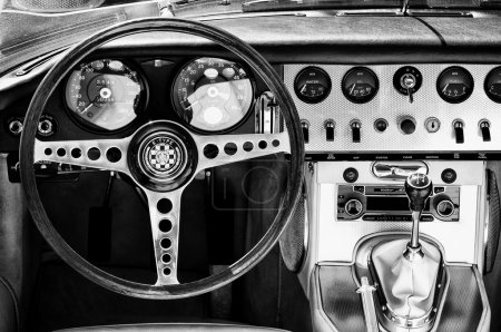 """PAAREN IM GLIEN, GERMANY - MAY 26: Cabin car Jaguar E-Type (Black - White), """"The oldtimer show"""" in MAFZ, May 26, 2012 in Paaren im Glien, Germany"""