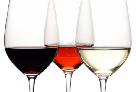 Three Wine Glasses Filled with White, Rosé and White Wine