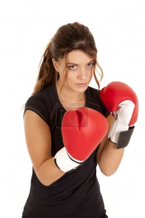 Woman boxing gloves serious