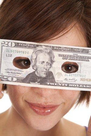 Greed eye hold money