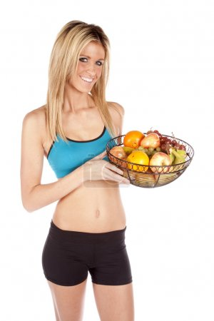 Fit woman holding fruit basket