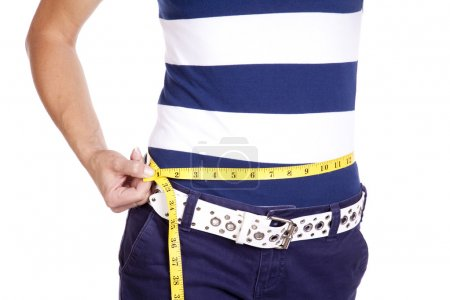 Woman in blue and white measuring waist