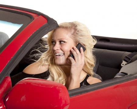 Blond woman happy phone car