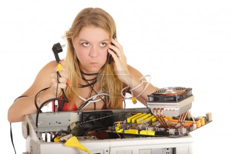 Photo for Bored woman calling technical support to repair computer - Royalty Free Image
