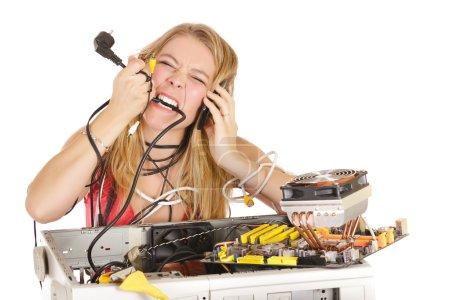 Blond woman repairing computer