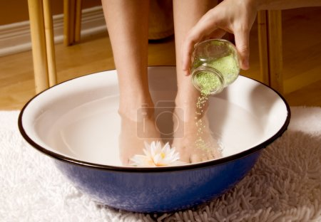 Photo for Woman in foot bowl at a spa - Royalty Free Image