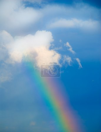 Photo for Rainbow in the sky during rain on blue - Royalty Free Image