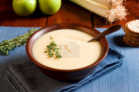 Photo for Apple and Leek Soup on a rustic table - Royalty Free Image