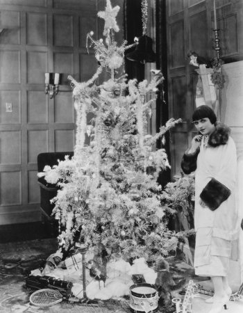 Woman with Christmas tree and gifts