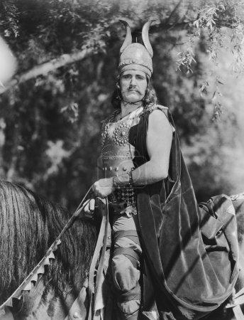 Photo for Portrait of Viking man on horseback - Royalty Free Image