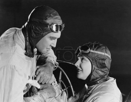 Couple in racing hats and goggles