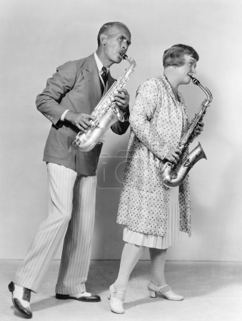 Couple playing saxophones together