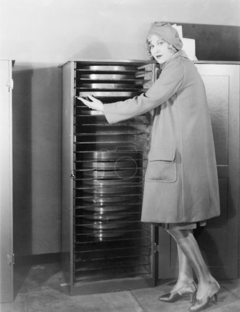 Woman with cabinet of movie production equipment