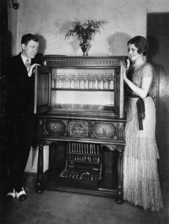 Proud couple with china cabinet
