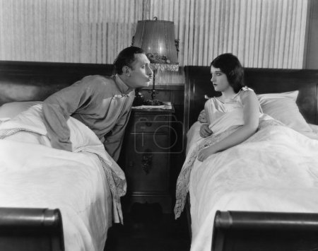 Couple in twin beds