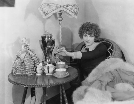 Woman with urn and teacups