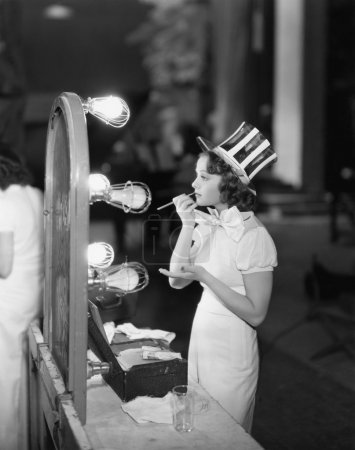 Photo for Woman in costume applying makeup - Royalty Free Image