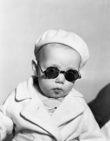 Portrait of baby wearing beret and sunglasses