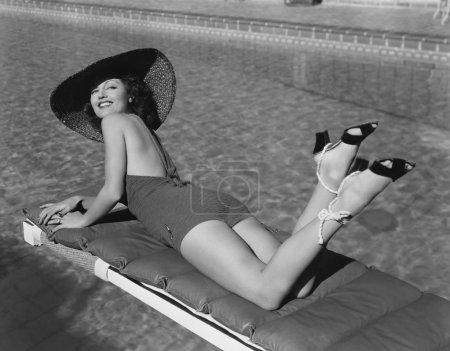 Woman sunbathing at pool