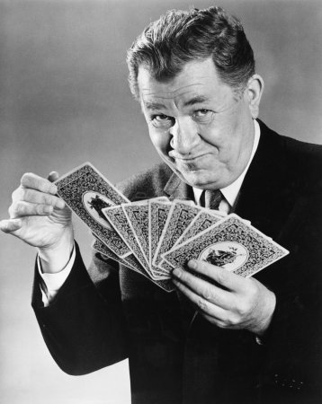Portrait of man with large cards