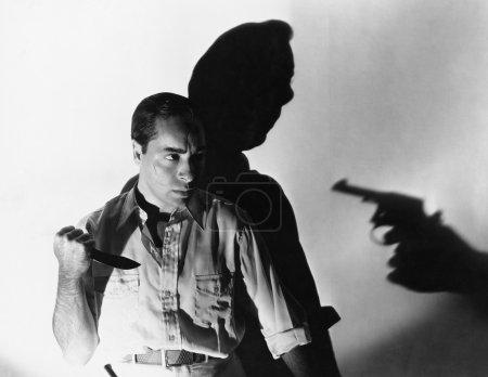 Man with knife at gunpoint