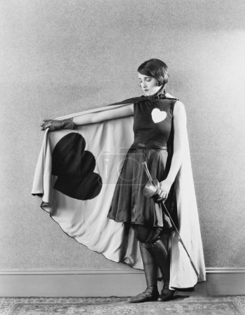 Female sword fighter wearing cape with hearts