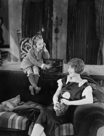 Boy and mother with radio