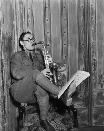 Saxophone player reading music on foot