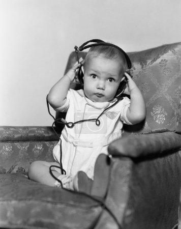 Portrait of baby wearing headphones