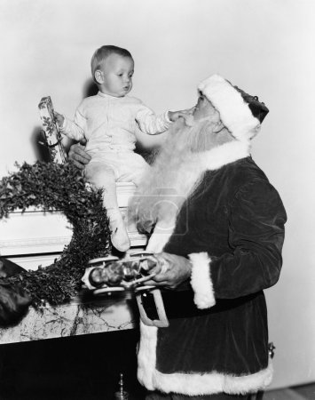 Santa Claus with baby on mantle