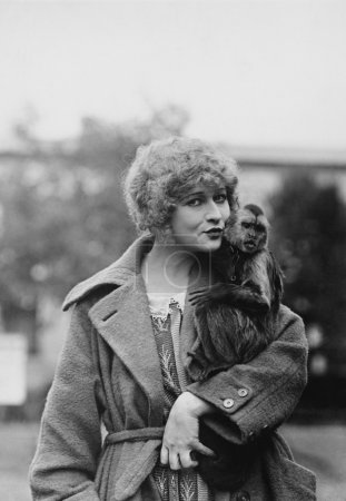 Portrait of woman with monkey...