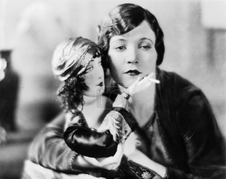 Woman with doll holding cigarette