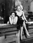 Portrait of two women smoking on bar