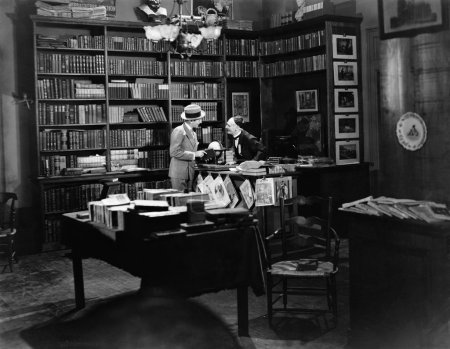 Customer and clerk in book shop