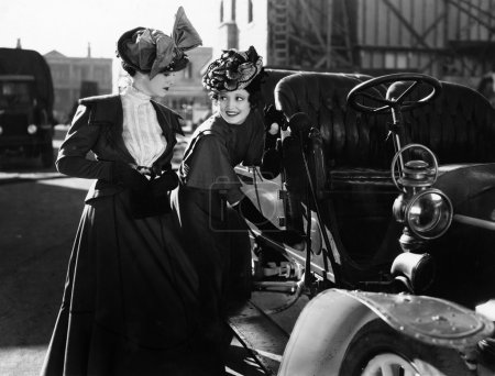 Two women with car