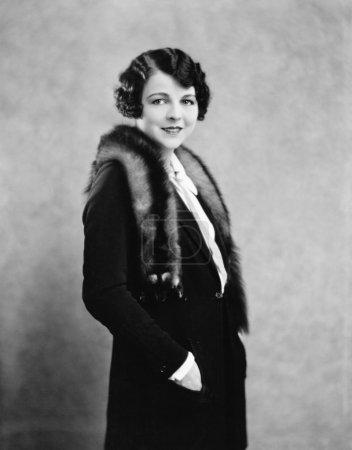Portrait of woman wearing fur