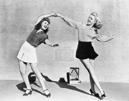 Two women dancing outside