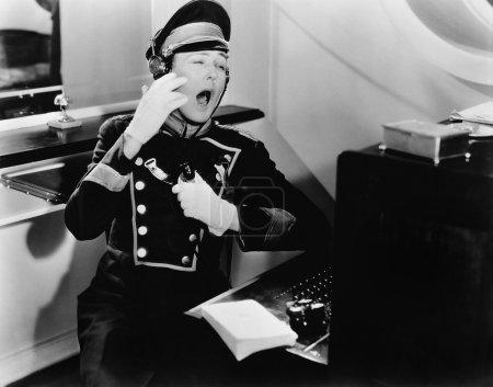 Yawning switchboard operator