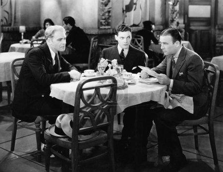 Businessmen meeting in restaurant
