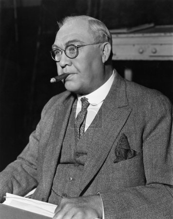 Portrait of businessman smoking cigar