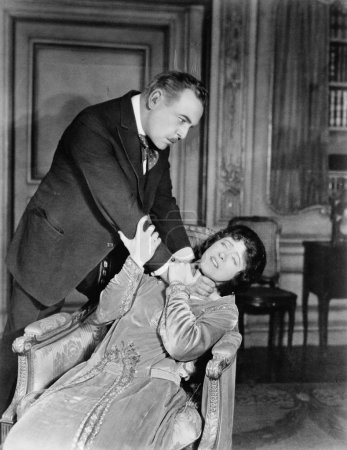 Man choking woman