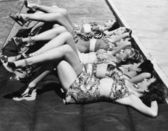 Group of women relaxing in a row together