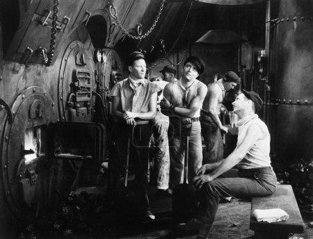 Men together in a ship's boiler room