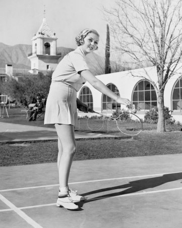 Photo for Woman playing badminton - Royalty Free Image