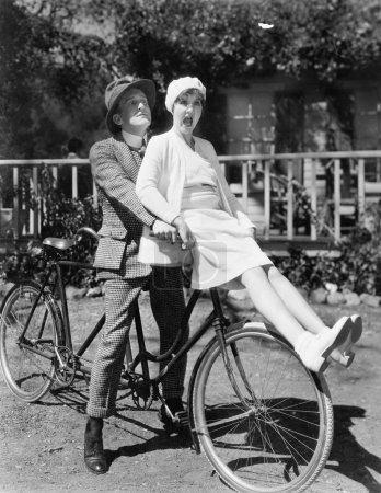 Couple sitting on a tandem bicycle