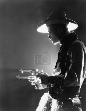 Profile of a young man holding guns